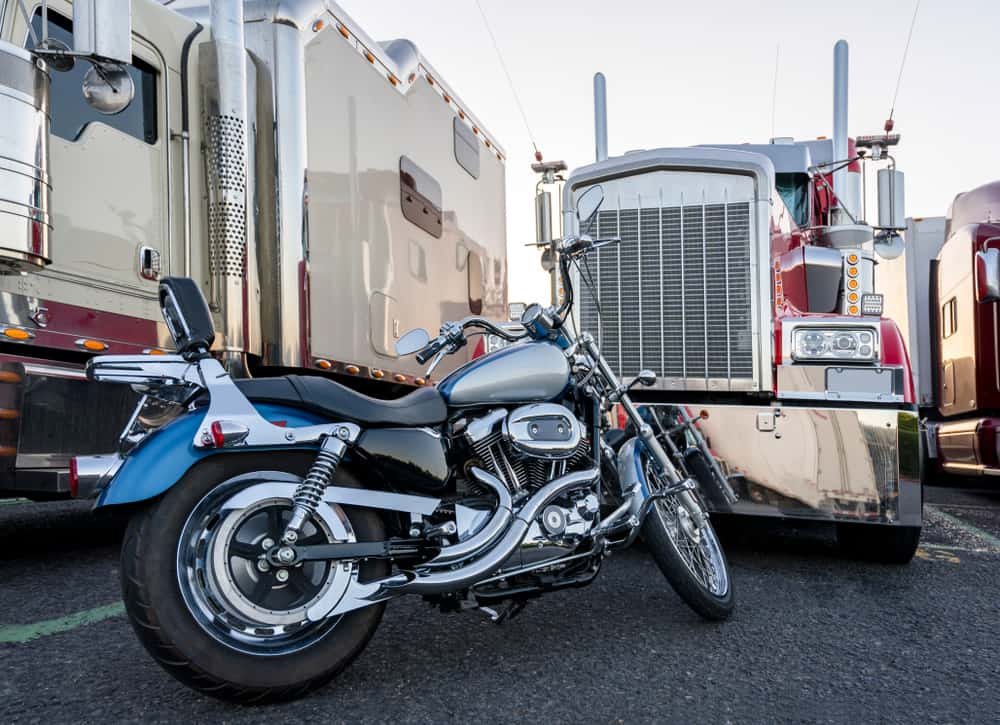 Moving with a motorcycle in trucks